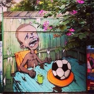 La coupe du monde, vu par l'artiste Paulo Ito. Lequel a peint ce graffiti à l'entrée d'une école de São Paulo